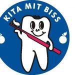 """Das Bild zeigt das Logo der Aktion """"Kita mit Biss""""."""