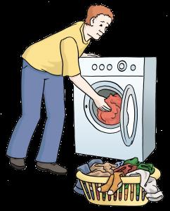 Sie sehen einen Mann der eine Waschmaschine mit Wäsche füllt.